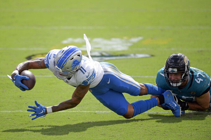 Detroit Lions wide receiver Marvin Jones Jr. (11) is stopped by Jacksonville Jaguars linebacker Joe Schobert (47) after a reception during the first half of an NFL football game, Sunday, Oct. 18, 2020, in Jacksonville, Fla. (AP Photo/Phelan M. Ebenhack)