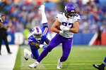 Minnesota Vikings tight end Cole Hikutini (87) eludes a tackle by Buffalo Bills linebacker Maurice Alexander (41) during the first half of an NFL preseason football game in Orchard Park, N.Y., Thursday, Aug. 29, 2019. (AP Photo/David Dermer)