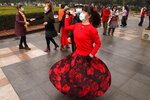 Residents wear masks as they dance at a park in Wuhan in central China's Hubei Province on Saturday, Jan. 23, 2021. A year after it was locked down to contain the spread of coronavirus, the central Chinese city of Wuhan has largely returned to normal, even as China continues to battle outbreaks elsewhere in the country. (AP Photo/Ng Han Guan)
