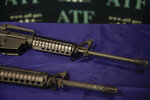 FILE - Homemade rifles are displayed on a table at an ATF field office in Glendale, Calif. in this Tuesday, Aug. 29, 2017, file photo. California's attorney general is suing the Trump administration in an effort to crack down on so-called