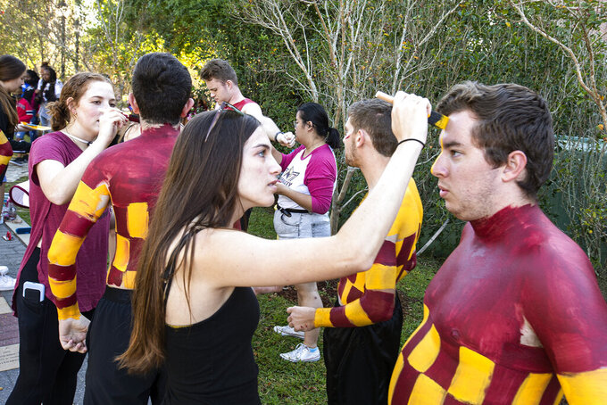 Michael Welch, right, with the Florida State Checker Boys, get made before an NCAA college football game against Massachusetts in Tallahassee, Fla., Saturday, Oct. 23, 2021. (AP Photo/Mark Wallheiser)