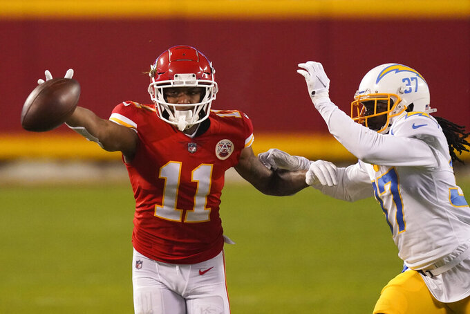 Los Angeles Chargers cornerback Tevaughn Campbell breaks up a pass intended for Kansas City Chiefs wide receiver Demarcus Robinson (11) during the second half of an NFL football game, Sunday, Jan. 3, 2021, in Kansas City. (AP Photo/Charlie Riedel)