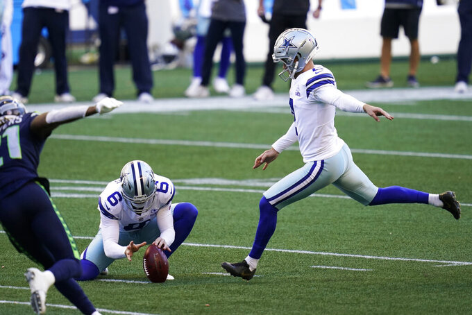 Dallas Cowboys kicker Greg Zuerlein, right, kicks a field goal as Chris Jones (6) holds during the second half of an NFL football game against the Seattle Seahawks, Sunday, Sept. 27, 2020, in Seattle. (AP Photo/Elaine Thompson)