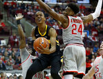 Iowa guard Maishe Dailey, center, goes up for a shot between Ohio State forward Luther Muhammad, left, and forward Andre Wesson during the first half of an NCAA college basketball game in Columbus, Ohio, Tuesday, Feb. 26, 2019. (AP Photo/Paul Vernon)