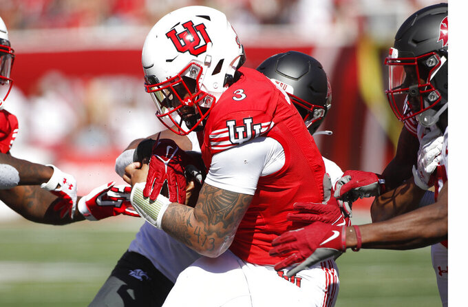 Utah quarterback Ja'Quinden Jackson (3) has the ball stripped from him by Washington State linebacker Travion Brown (B) at the goal line in the second half, of an NCAA college football game Saturday, Sept. 25, 2021, in Salt Lake City. (AP Photo/George Frey)