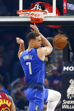 Dallas Mavericks' Dwight Powell dunks against the Cleveland Cavaliers in the first half of an NBA basketball game, Sunday, Nov. 3, 2019, in Cleveland. (AP Photo/Ron Schwane)