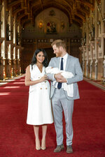 Britain's Prince Harry and Meghan, Duchess of Sussex, during a photocall with their newborn son, in St George's Hall at Windsor Castle, Windsor, south England, Wednesday May 8, 2019. Baby Sussex was born Monday at 5:26 a.m. (0426 GMT; 12:26 a.m. EDT) at an as-yet-undisclosed location. An overjoyed Harry said he and Meghan are