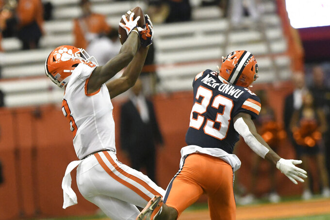 Clemson's Justyn Ross grabs a pass as Syracuse's Ifeatu Melifonwu chases during an NCAA college football game Saturday, Sept. 14, 2019, in Syracuse, N.Y. (AP Photo/Steve Jacobs)