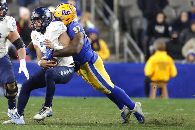 FILE - In this Nov. 14, 2019, file photo, Pittsburgh defensive lineman Jaylen Twyman (97) sacks North Carolina quarterback Sam Howell (7) during the second half of an NCAA college football game, in Pittsburgh. Twyman was selected to The Associated Press preseason All-America first-team, Tuesday, Aug. 25, 2020. (AP Photo/Keith Srakocic, File)