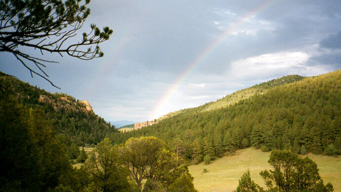 FILE - In this July 2001 file photo, a double rainbow is shown in the early evening in Philmont Scout Ranch, N.M. The vast Philmont Scout Ranch,  one of the most spectacular properties owned by the financially struggling Boy Scouts of America, has been mortgaged by the BSA, according to member of Philmont's oversight committee.  (AP Photo/Ira Dreyfuss, File)