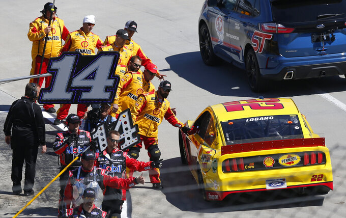 NASCAR Cup Series driver Joey Logano (22) is greeted by his pit crew prior to a NASCAR Cup Series auto race at Martinsville Speedway in Martinsville, Va., Sunday, March 24, 2019. (AP Photo/Steve Helber)