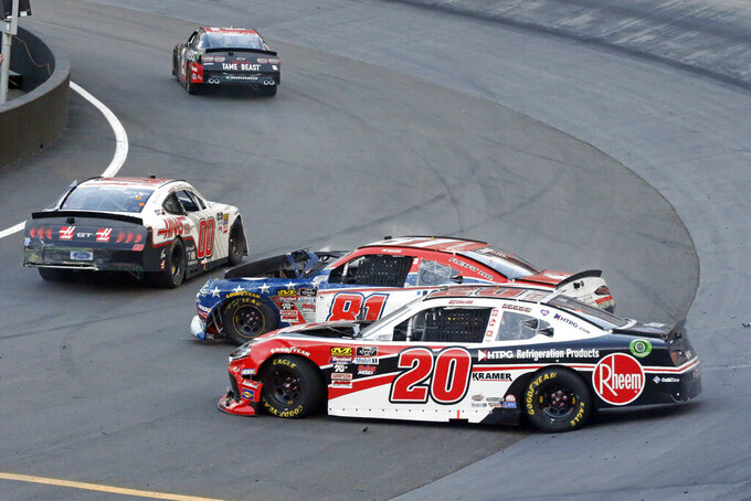 The cars of Christopher Bell (20), Cole Custer (00) and Erik Jones (81) sit on the track after a collision during the NASCAR Xfinity Series auto race Friday, Aug. 16, 2019, in Bristol, Tenn. (AP Photo/Wade Payne)