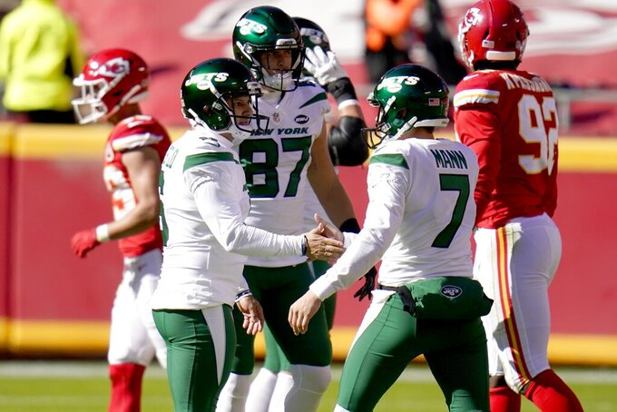 New York Jets' Sergio Castillo, center left, and Braden Mann (7) celebrate a field goal kicked by Castillo in the first half of an NFL football game against the Kansas City Chiefs on Sunday, Nov. 1, 2020, in Kansas City, Mo. (AP Photo/Jeff Roberson)