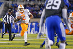 Tennessee quarterback Jarrett Guarantano (2) runs with the ball during the second half of the team's NCAA college football game against Kentucky, Saturday, Nov. 9, 2019, in Lexington, Ky. (AP Photo/Bryan Woolston)