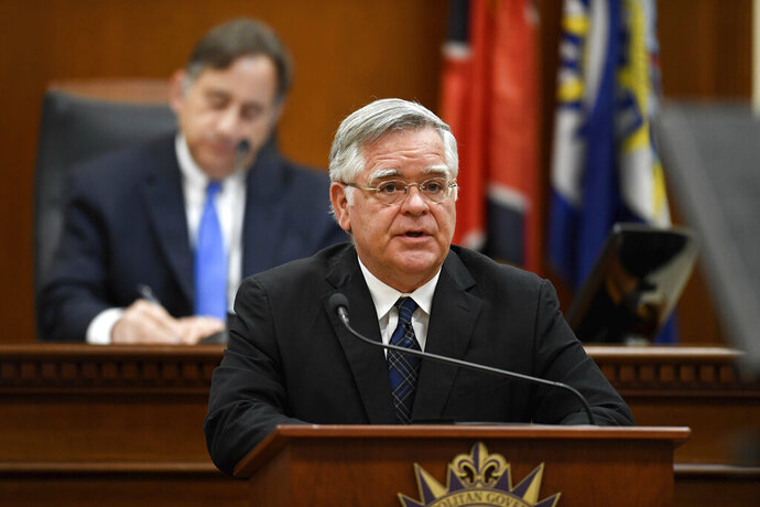 FILE - In this March 31, 2020 file photo, Nashville Mayor John Cooper delivers the State of Metro Address from the Council Chambers at the Metro Courthouse in Nashville, Tenn. Cooper said on Thursday, July 2, 2020 the city will roll back its reopening in response to a sharp increase in coronavirus cases. (George Walker IV/The Tennessean via AP, File)