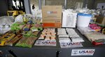 USAID humanitarian aid destined for Venezuela is displayed for the media at a warehouse next to the Tienditas International Bridge on the outskirts of Cucuta, Colombia, on the border with Venezuela, Tuesday, Feb. 19, 2019. The U.S. military airlifted tons of humanitarian aid as part of an effort meant to undermine socialist President Nicolas Maduro and back his rival for the leadership of the South American nation. (AP Photo/Fernando Vergara)