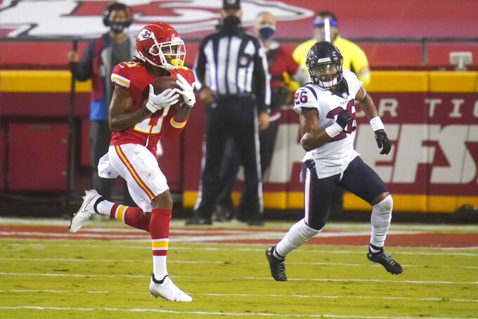 Kansas City Chiefs wide receiver Demarcus Robinson, left, catches a pass as he is defended by Houston Texans cornerback Vernon Hargreaves III (26) in the first half of an NFL football game Thursday, Sept. 10, 2020, in Kansas City, Mo. (AP Photo/Jeff Roberson)