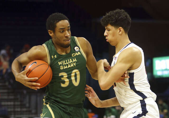 William & Mary forward Mehkel Harvey (30) moves past Virginia forward Kadin Shedrick (21) during an NCAA college basketball  game Tuesday, Dec. 22, 2020, in Charlottesville, Va. (Andrew Shurtleff/The Daily Progress via AP)