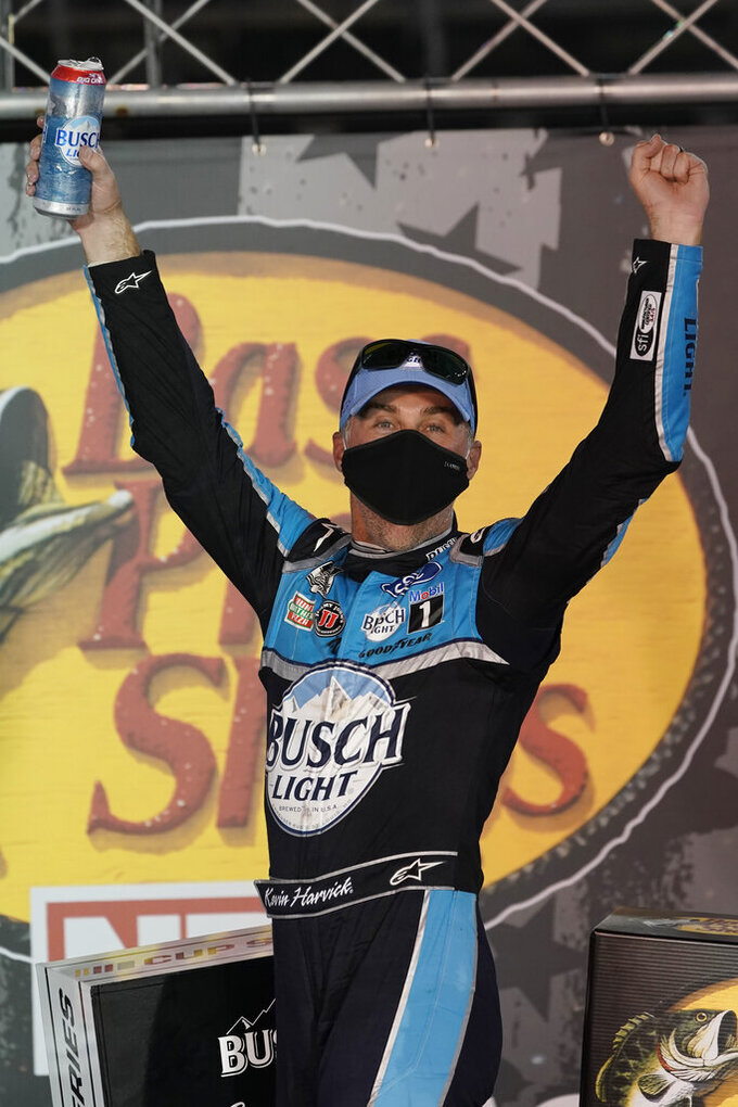 Kevin Harvick celebrates in Victory Lane after his win in the NASCAR Cup Series auto race Saturday, Sept. 19, 2020, in Bristol, Tenn. (AP Photo/Steve Helber)