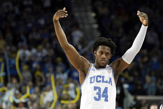 UCLA guard David Singleton celebrates during the second half of an NCAA college basketball game against Arizona in Los Angeles, Saturday, Feb. 29, 2020. UCLA won 69-64. (AP Photo/Chris Carlson)