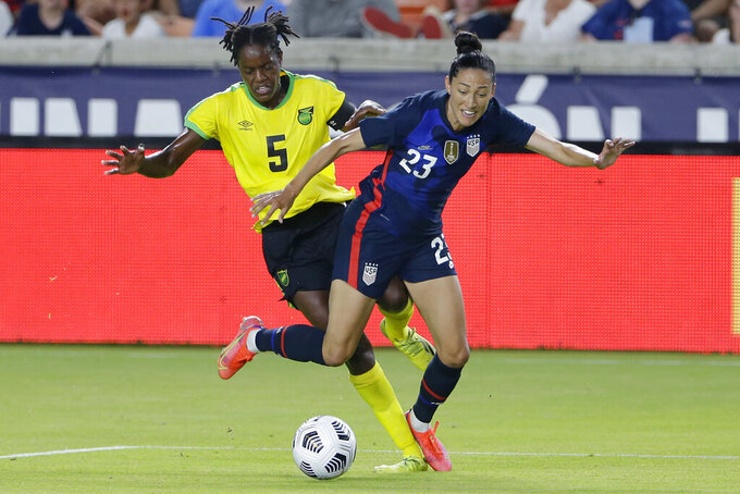 FILE - Jamaica defender Konya Plummer (5) and USA forward Christen Press (23) get tangled up while chasing the ball during the first half of their 2021 WNT Summer Series soccer match in Houston, in this Sunday, June 13, 2021, file photo. After getting memorably eliminated by Sweden at the Brazil Olympics, the U.S. Women's national team has something to prove in Tokyo. (AP Photo/Michael Wyke, File)
