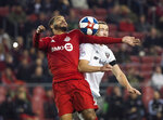 Toronto FC forward Jordan Hamilton, left, eyes the ball against D.C. United midfielder Russell Canouse, right, during the second half of an MLS soccer game, Wednesday, May 15, 2019 in Toronto. (Nathan Denette/The Canadian Press via AP)