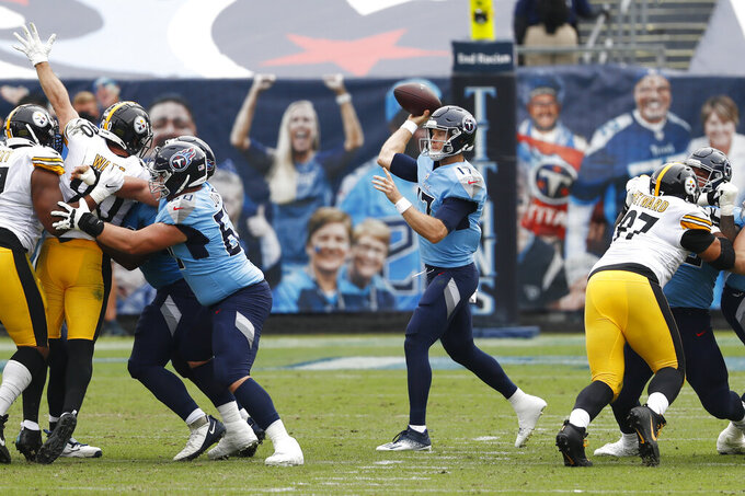 Tennessee Titans quarterback Ryan Tannehill (17) passes against the Pittsburgh Steelers in the first half of an NFL football game Sunday, Oct. 25, 2020, in Nashville, Tenn. (AP Photo/Wade Payne)