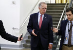 Sen. Thom Tillis, R-N.C., talks with reporters as he departs after head a vote on Gina Haspel to be CIA director, on Capitol Hill, Thursday, May 17, 2018 in Washington. The Senate confirmed Haspel as the first female director of the CIA following a difficult nomination process that reopened an emotional debate about brutal interrogation techniques in one of the darkest chapters in the spy agency's history. (AP Photo/Alex Brandon)