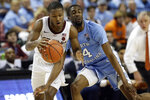 Virginia Tech guard Jalen Cone (15) dribbles while North Carolina guard Brandon Robinson (4) defends during the second half of an NCAA college basketball game at the Atlantic Coast Conference tournament in Greensboro, N.C., Tuesday, March 10, 2020. (AP Photo/Gerry Broome)