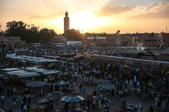 FILE - In this Saturday, Nov. 5, 2016 file photo, people gather in the landmark Jemaa el-Fnaa square, in Marrakesh, Morocco. A FIFA task force arrived in Morocco on Monday, April 16, 2018 to inspect a World Cup bid that obscures one potential impediment to hosting the 2026 soccer showpiece: homosexuality is a criminal offense in the north African country. An Associated Press review of 483 pages of documents submitted to FIFA found Morocco failed to declare its anti-LGBT law as a risk factor and provide a remedy, appearing to flout stringent new bidding requirements.(AP Photo/Mosa'ab Elshamy, file)