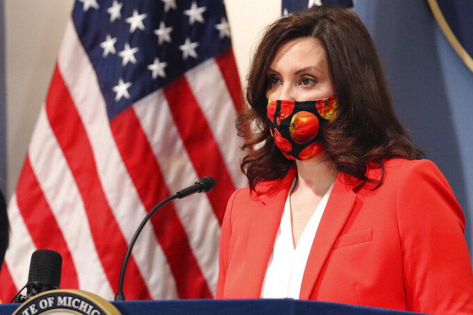 """FILE - In this Feb. 24, 2021, file photo provided by the Michigan Office of the Governor, Gov. Gretchen Whitmer addresses the state during a speech in Lansing, Mich. Michigan, which not long ago had one of the country's lowest COVID-19 infection rates, is confronting an alarming spike that some experts worry could be a harbinger nationally. """"It's a stark reminder that this virus is still very real. It can come roaring back if we drop our guard,"""" said Whitmer, who does not plan to tighten restrictions on indoor dining, sports and other activities that were eased in recent months. (Michigan Office of the Governor via AP, File)"""