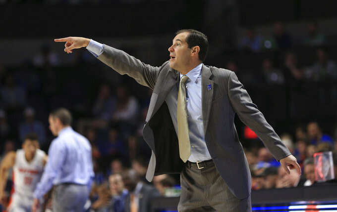 Baylor head coach Scott Drew points to his players during the first half of an NCAA college basketball game against Florida, Saturday, Jan. 25, 2020, in Gainesville, Fla. (AP Photo/Matt Stamey)