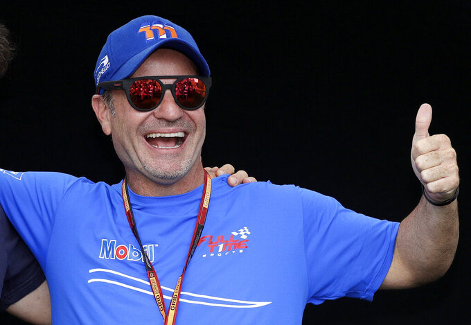 Brazilian Rubens Barrichello poses for a photo at the Australian Formula One Grand Prix in Melbourne, March 12, 2020. Ex-Formula One driver Barrichello will have to wait until next year to race on one of Australia's most iconic layouts. Officials on Wednesday, Oct. 7, 2020, said the inaugural Bathurst International at Mount Panorama has been postponed until 2021 because of COVID-19 restrictions. (AP Photo/Rick Rycroft)