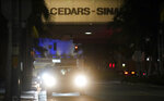 A police vehicle idles outside Cedars-Sinai Medical Center, late Tuesday, Jan. 5, 2021, in Los Angeles. Music producer and hip hop legend Dr. Dre is hospitalized in the intensive care unit at Cedars-Sinai after suffering a brain aneurysm Monday. (AP Photo/Chris Pizzello)