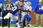 Detroit Lions wide receiver Danny Amendola (80) is tackled by Dallas Cowboys cornerback Jourdan Lewis (27) during the first half of an NFL football game, Sunday, Nov. 17, 2019, in Detroit. (AP Photo/Paul Sancya)