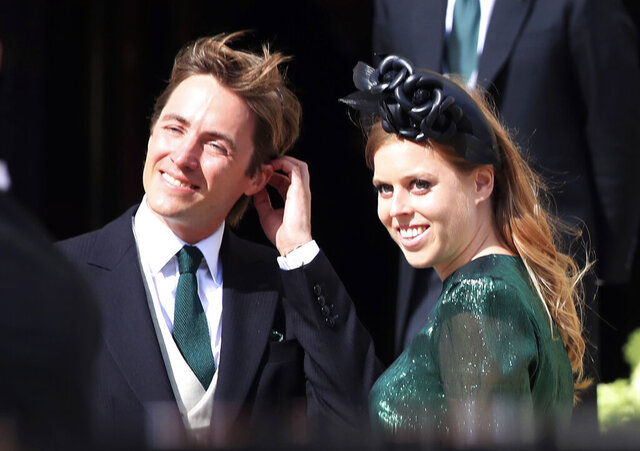 FILE - In this Aug. 31, 2019 file photo, Britain's Princess Beatrice with her fiance, Edoardo Mapelli Mozzi, attend the wedding of Ellie Goulding and Caspar Jopling, in York, England. Buckingham Palace says that Princess Beatrice has got married in a private ceremony, with her grandmother Queen Elizabeth II in attendance. Beatrice married Edoardo Mapelli Mozzi Friday, July 17, 2020 at The Royal Chapel of All Saints at Royal Lodge, Windsor. The monarch, the Duke of Edinburgh and other close family members attended, in line with COVID-19 guidelines. (Peter Byrne/PA via AP, file)