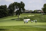Keith Mitchell, Ryan Armour and Stewart Cink walk up the 18th fairway during opening round of the Workday Charity Open golf tournament, Thursday, July 9, 2020, in Dublin, Ohio. (AP Photo/Darron Cummings)