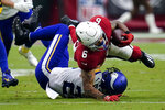Arizona Cardinals running back James Conner (6) is hit by Minnesota Vikings free safety Harrison Smith during the second half of an NFL football game, Sunday, Sept. 19, 2021, in Glendale, Ariz. (AP Photo/Ross D. Franklin)