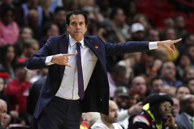 Miami Heat head coach Erik Spoelstra watches during the first half of an NBA basketball game against the Washington Wizards, Wednesday, Jan. 22, 2020, in Miami. The Heat won 134-129 in overtime. (AP Photo/Lynne Sladky)
