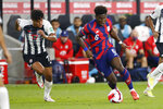 United States' Yunus Musah, right, tries to dribble past Costa Rica's Yeltsin Tejeda during the first half of a World Cup qualifying soccer match Wednesday, Oct. 13, 2021, in Columbus, Ohio. (AP Photo/Jay LaPrete)