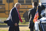 President Donald Trump walks to his car after arrive in Southampton, N.Y., on Marine One, Saturday, Aug. 8, 2020. Trump is attending two fundraisers during his visit to the Hamptons. (AP Photo/Susan Walsh)