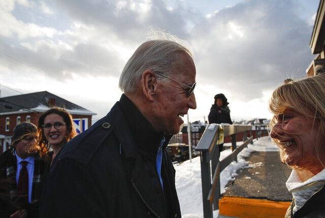 Democratic presidential candidate former Vice President Joe Biden speaks with a supporter outside the Biden for President Manchester Field Office, Saturday, Feb. 8, 2020 in Manchester, N.H. (AP Photo/Pablo Martinez Monsivais)