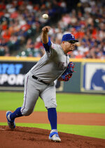 Texas Rangers pitcher Ariel Jurado delivers to a Houston Astros batter in the first inning of a baseball game Saturday, July 20, 2019, in Houston. (AP Photo/Richard Carson)