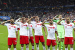 FILE-In this Monday, Oct. 14, 2019 file photo, Turkey's players salute as they celebrate a goal against France during the Euro 2020 group H qualifying soccer match between France and Turkey at Stade de France at Saint Denis, north of Paris, France. Since Turkey announced its incursion into neighbouring Syria to clear out Kurdish fighters last week, patriotic sentiment has run high, with the National soccer team players giving military salutes during international matches among the outward signs of nationalism. (AP Photo/Thibault Camus, File)