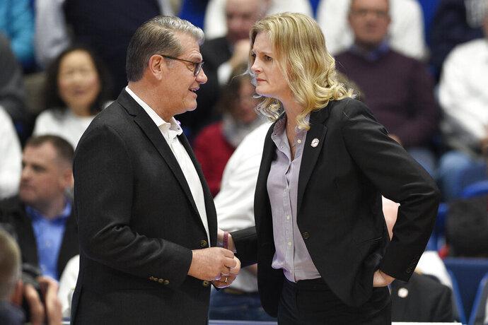 Connecticut head coach Geno Auriemma, left, talks with Tennessee head coach Kellie Harper before of an NCAA college basketball game, Thursday, Jan. 23, 2020, in Hartford, Conn. (AP Photo/Jessica Hill)