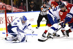 Tampa Bay Lightning goaltender Andrei Vasilevskiy (88) goes against Florida Panthers right wing Patric Hornqvist (70) as he stops a shot on the goal during the second period in Game 5 of an NHL hockey Stanley Cup first-round playoff series, Monday, May 24, 2021, in Sunrise, Fla. (AP Photo/Lynne Sladky)
