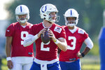 Indianapolis Colts quarterback Carson Wentz (2) throws during a drill during practice at the NFL team's football training camp in Westfield, Ind., Tuesday, Aug. 24, 2021. (AP Photo/Michael Conroy)