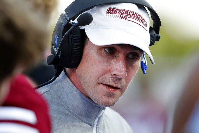 Massachusetts head coach Walt Bell talks to his team during the second half of an NCAA college football game against Boston College, Saturday, Sept. 11, 2021, in Amherst, Mass. (AP Photo/Michael Dwyer)