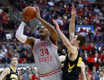 Ohio State forward Kaleb Wesson, left, goes up for a shot next to Iowa forward Nicholas Baer during the second half of an NCAA college basketball game in Columbus, Ohio, Tuesday, Feb. 26, 2019. Ohio State won 90-70. (AP Photo/Paul Vernon)