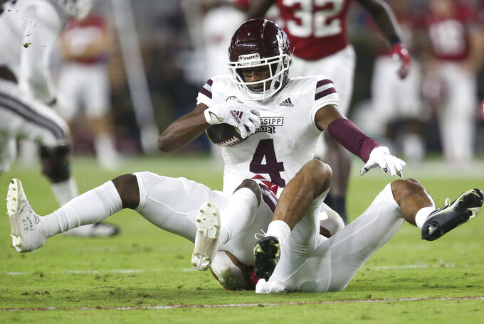 Mississippi State wide receiver Malik Heath (4) is tackled after making a catch on a short pass against Alabama during an NCAA college football game in Tuscaloosa, Ala., Saturday, Oct. 31, 2020. (Gary Cosby Jr./The Tuscaloosa News via AP)